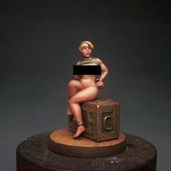 Woman Chained on Ammo Box